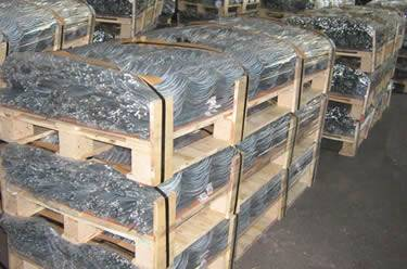 Many wooden pallets of galvanized tomato spiral stakes